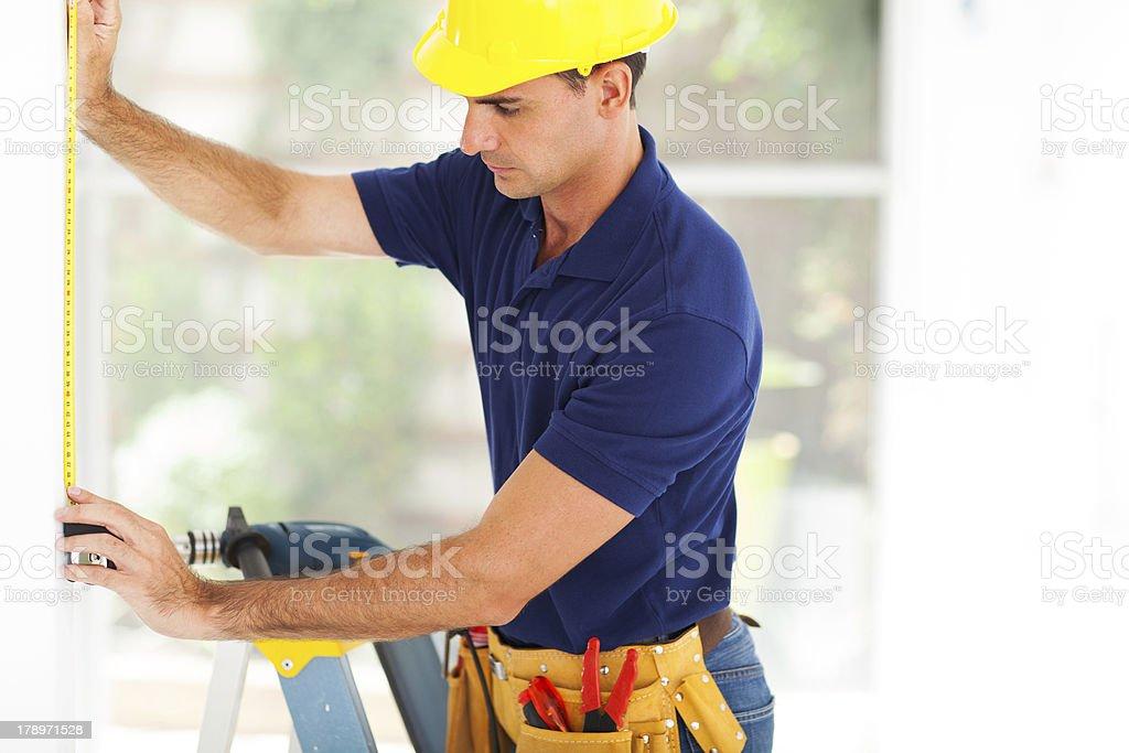 cctv guy installing security camera stock photo