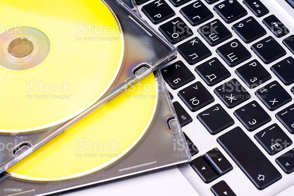 Cd discs on laptop stock photo