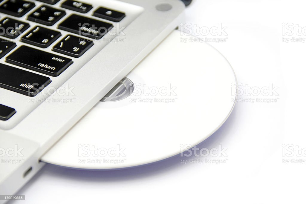 cd or dvd disk in laptop royalty-free stock photo