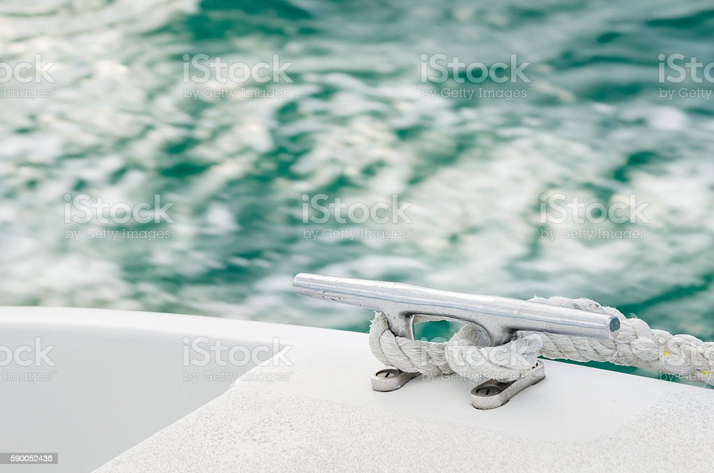 Còeat with a Rope on a Boat in Navigation stock photo