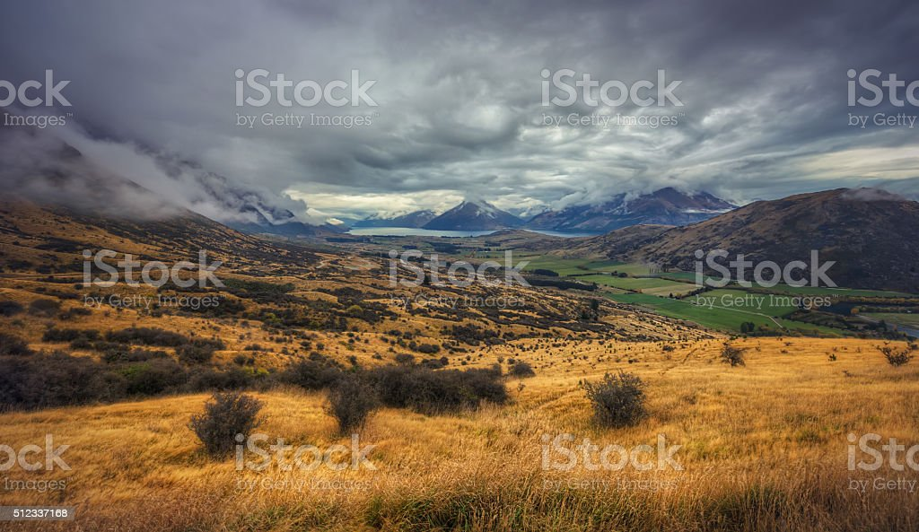 Cecil Peak, Queenstown In Cloud Cover Surrounded By Tussock Grassland stock photo