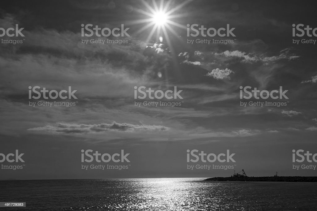 Cecina Sea, backlight sun in Black and White stock photo