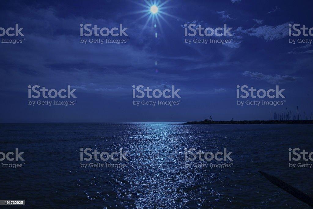 Cecina Sea, backlight sun in Blue stock photo