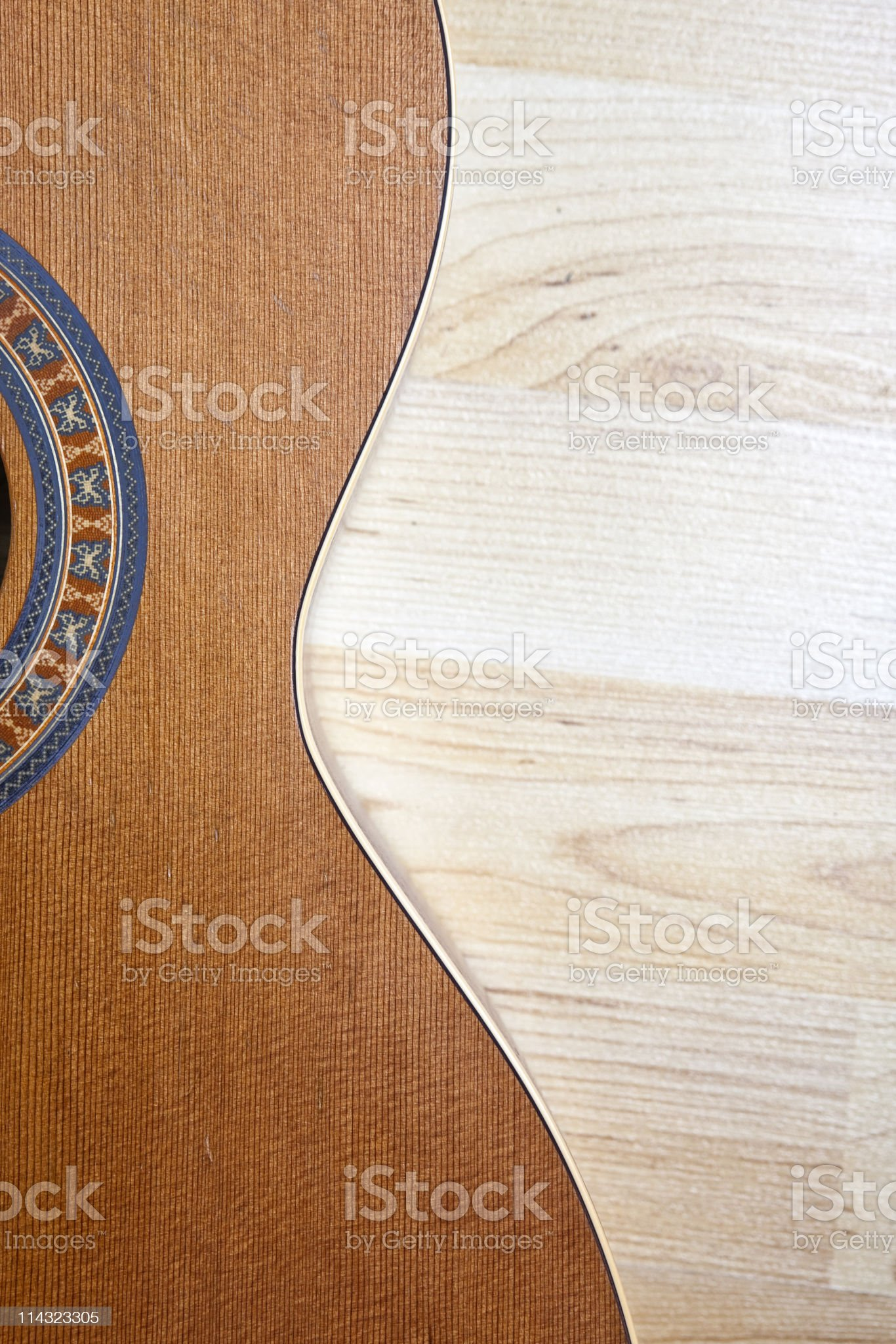 Cedar guitar against maple boards royalty-free stock photo