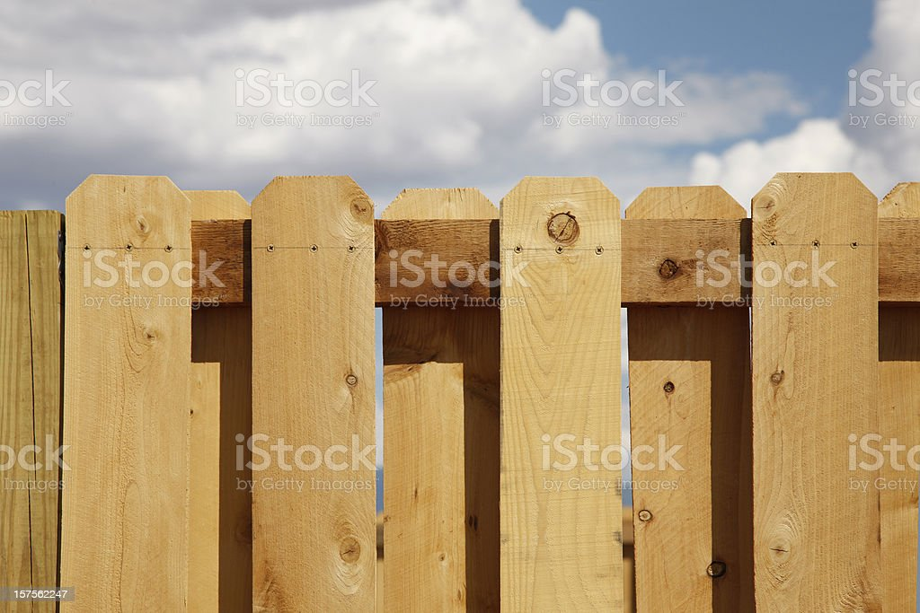 Cedar Picket Fence and Sky stock photo