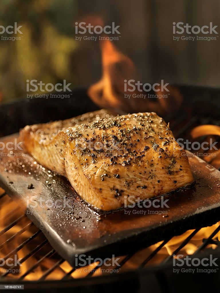 Cedar Plank Salmon Fillet on an outdoor BBQ stock photo
