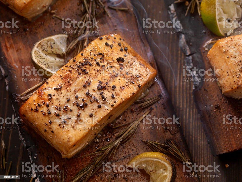Cedar Plank Salmon fillets hot off the BBQ stock photo