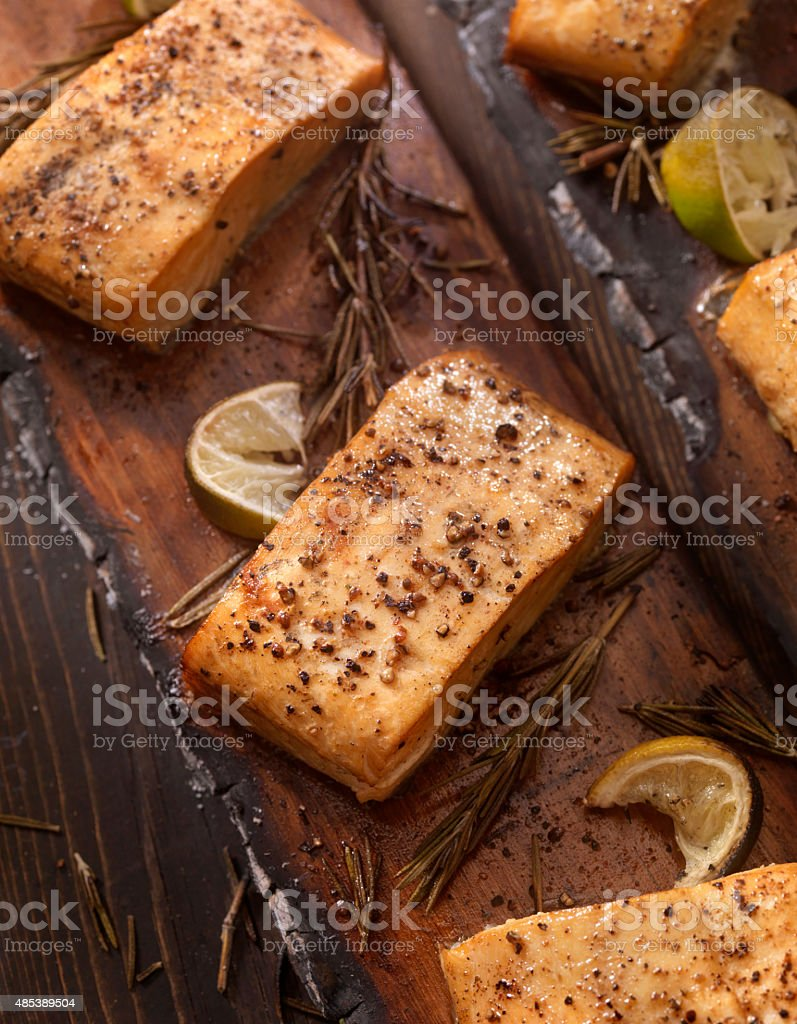 Cedar Plank Salmon fillets hot off the BBQ stock photo