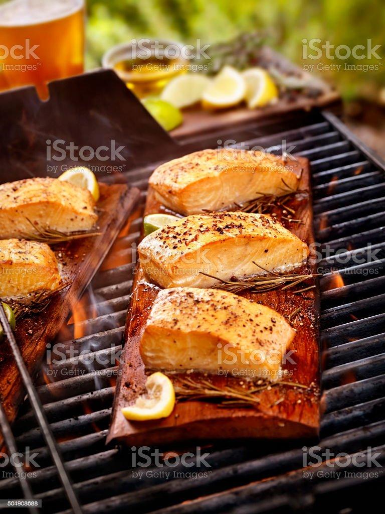 Cedar Plank Salmon Fillets on an outdoor BBQ stock photo