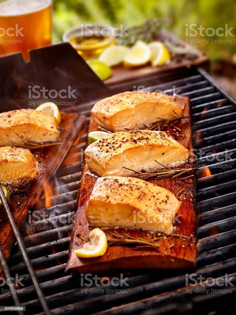 Cedar Plank Salmon Fillets on an outdoor BBQ stock photo