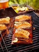 Cedar Plank Salmon Fillets on an outdoor BBQ