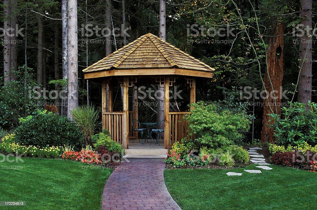 cedar wood gazebo back yard garden stock photo