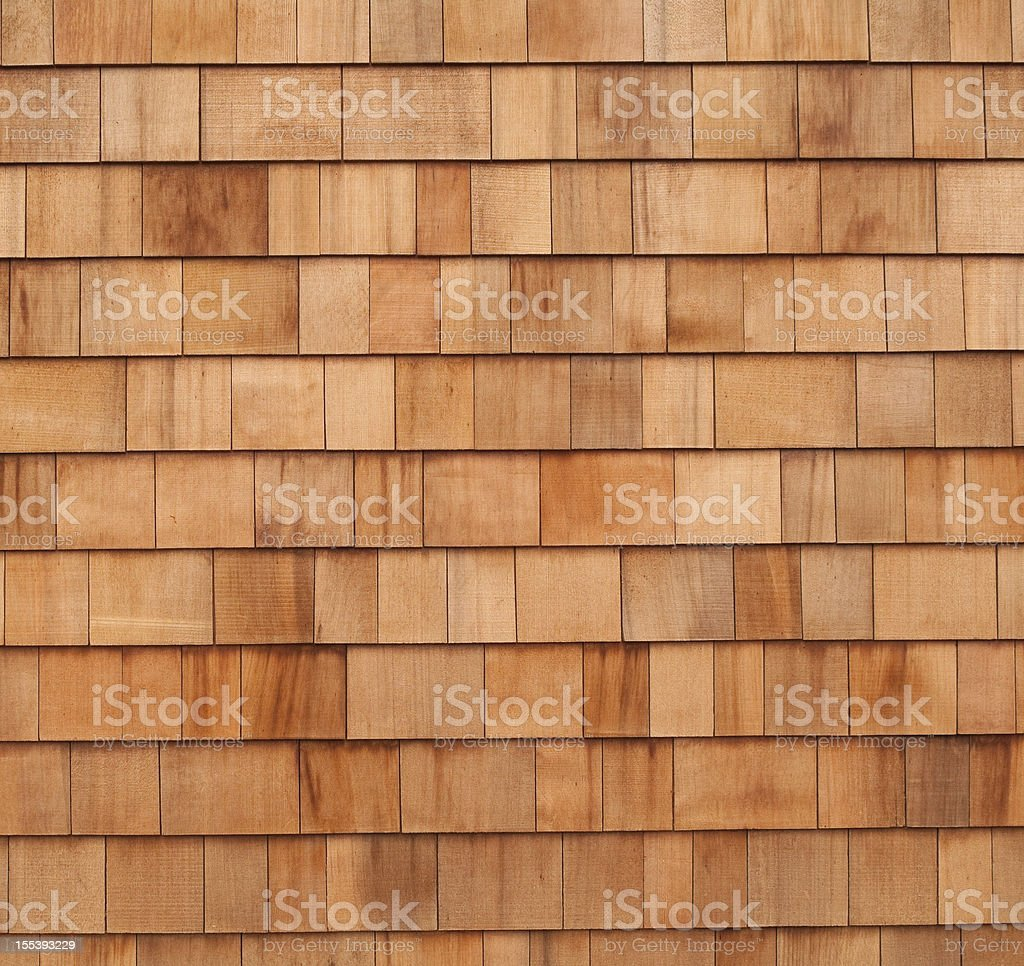 Cedar wood panels siding on house stock photo