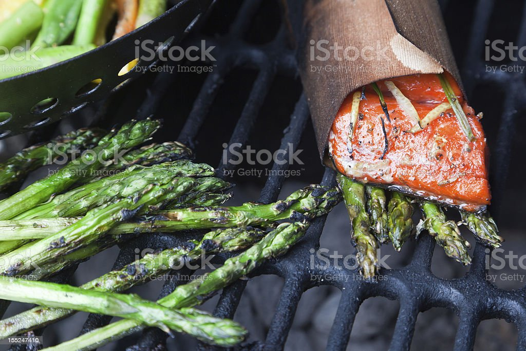 Cedar Wrapped Salmon and Asparagus on Grill royalty-free stock photo
