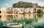 Cefalù, harbour and fisherman on boat