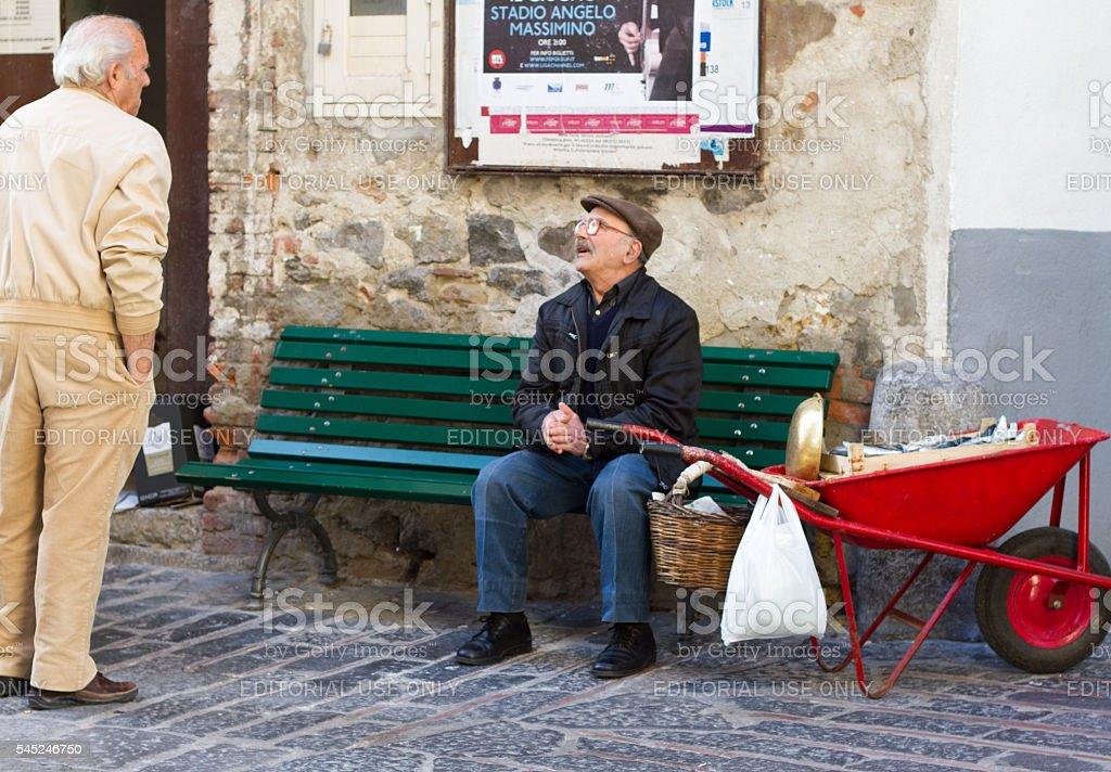 Cefalu, Sicily: Fishmonger with Red Wheelbarrow Full of Fish stock photo