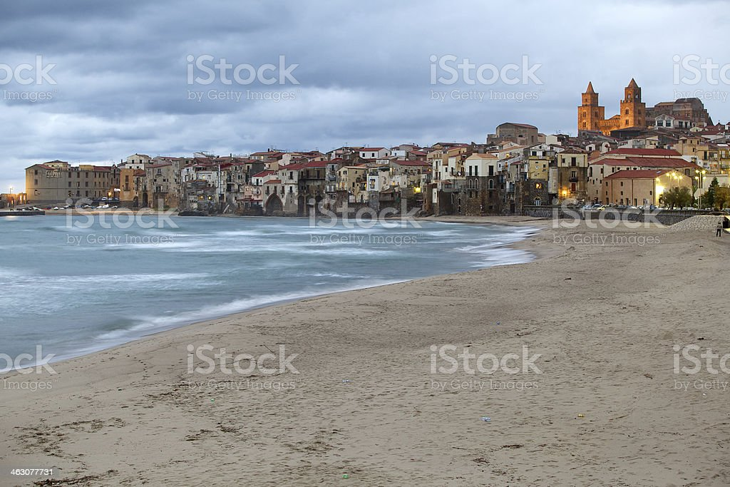 Cefalu-Sicily at twilight seen from the beach. stock photo