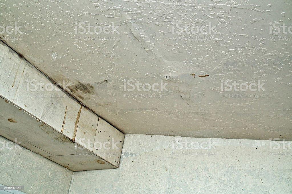 Ceiling damage from rain water leak stock photo