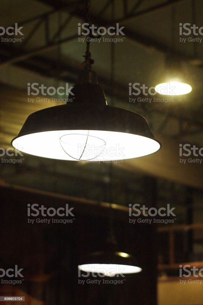 ceiling lamp Light system in industrial loft style stock photo