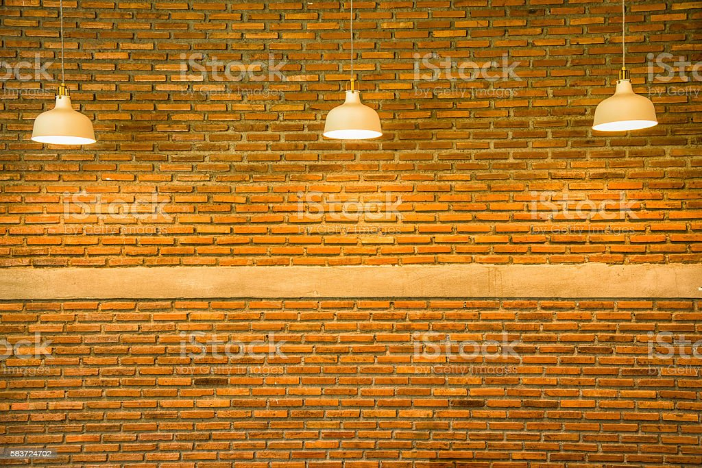 Ceiling light and brick wall stock photo