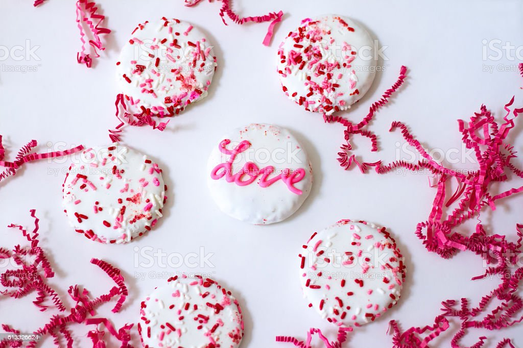 Celebrate Love: Pink and White Cookies with Sprinkles, White Background stock photo