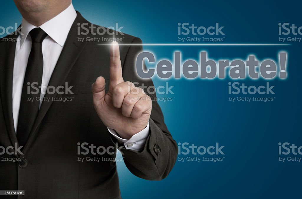 Celebrate touchscreen is operated by businessman stock photo