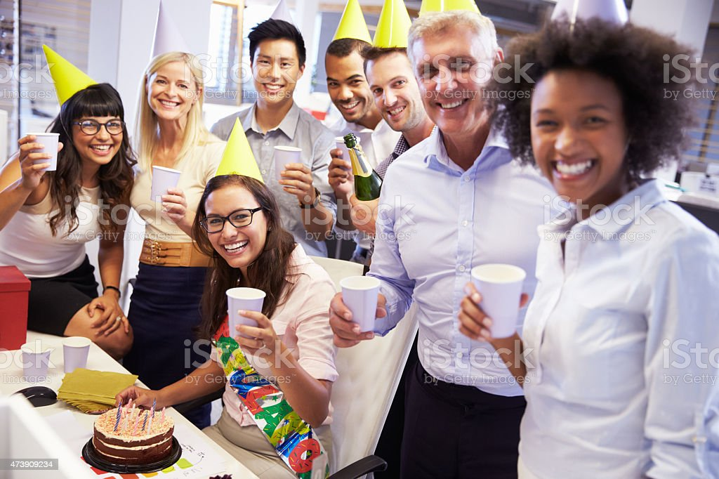 Celebrating a colleague's birthday in the office stock photo