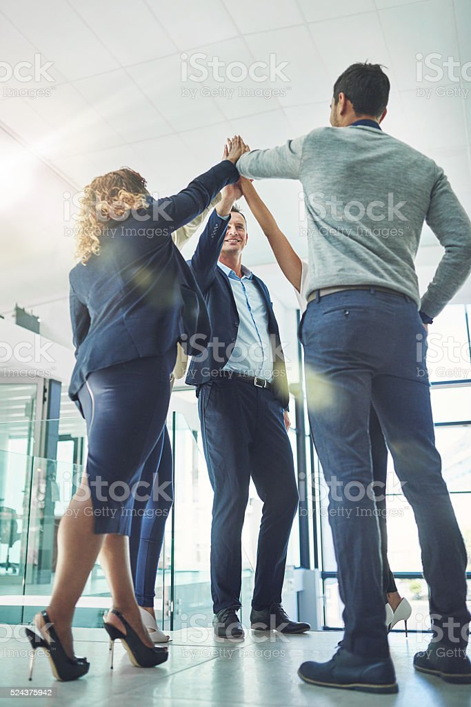 Celebrating another job well done stock photo