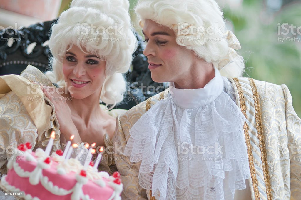 Celebrating Birthday in Old French Costumes stock photo