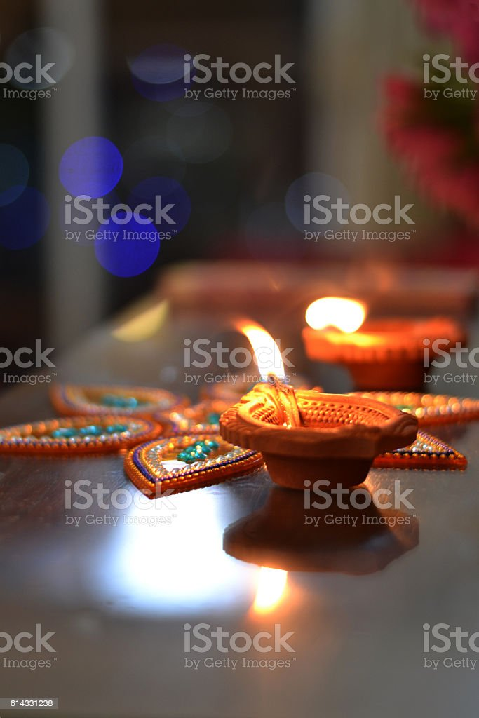Celebrating Diwali with lamps to welcome prosperity stock photo