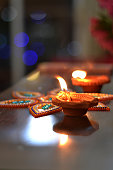 Celebrating Diwali with lamps to welcome prosperity