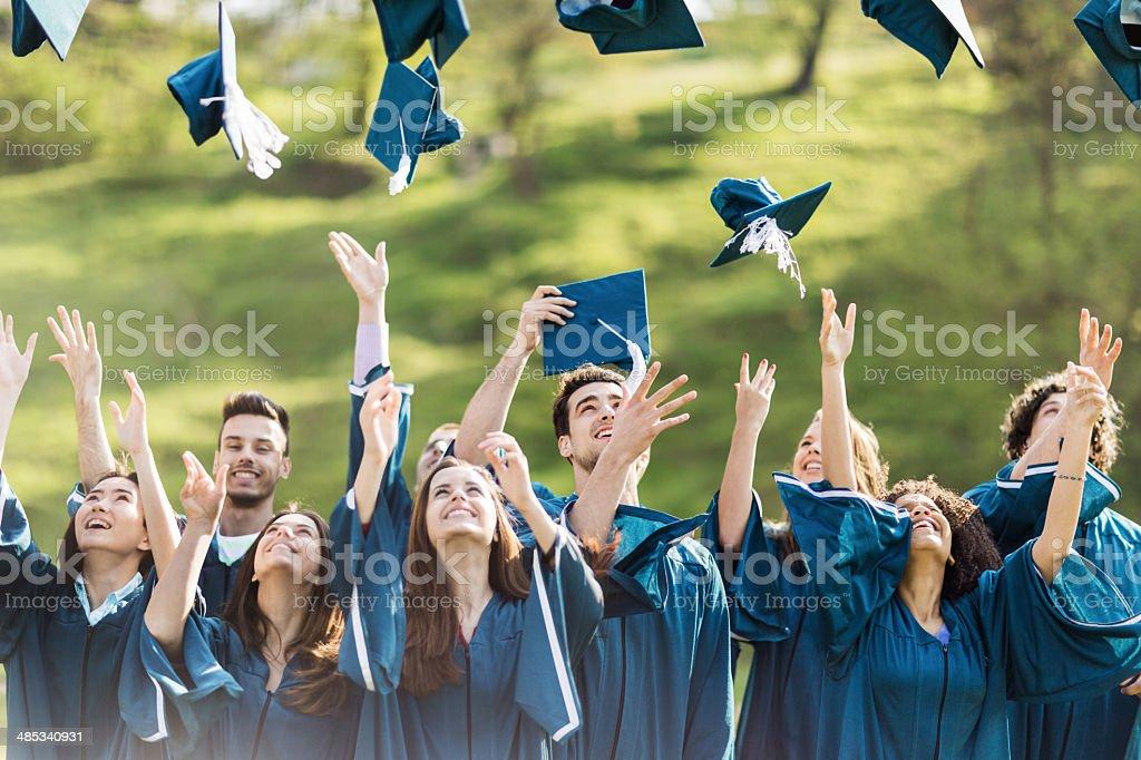 Celebrating graduation. stock photo