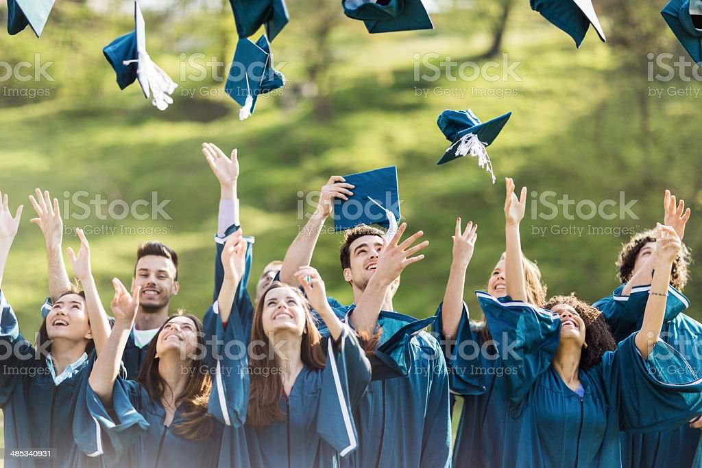Celebrating graduation. stock photo