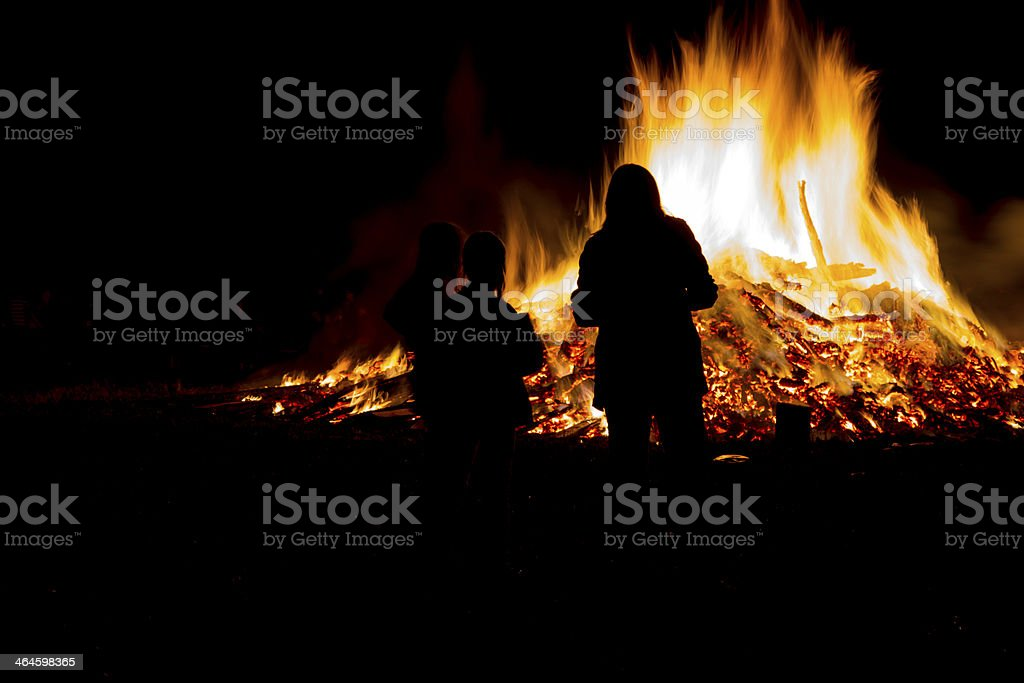 Celebrating midsummer with a large fire stock photo