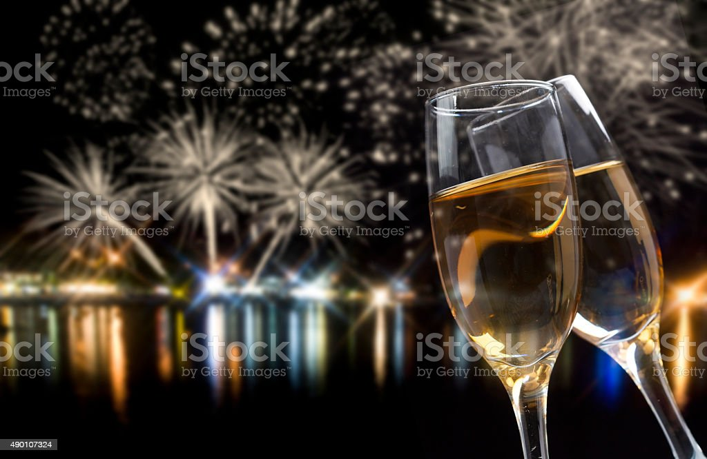 Celebrating New Year with champagne and fireworks stock photo
