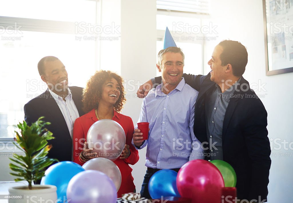 Celebrating office birthdays! stock photo