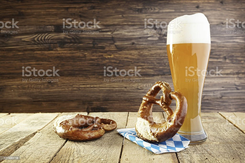 Celebrating Oktoberfest beer and a pretzel stock photo