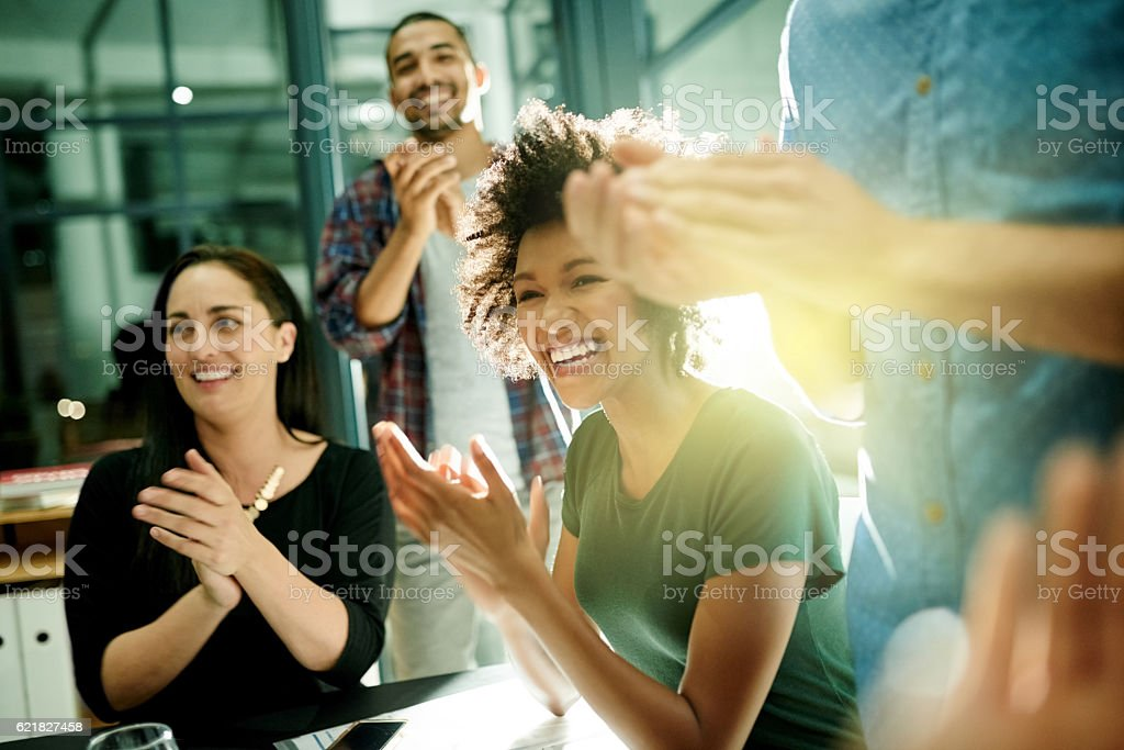 Celebrating our achievements together stock photo