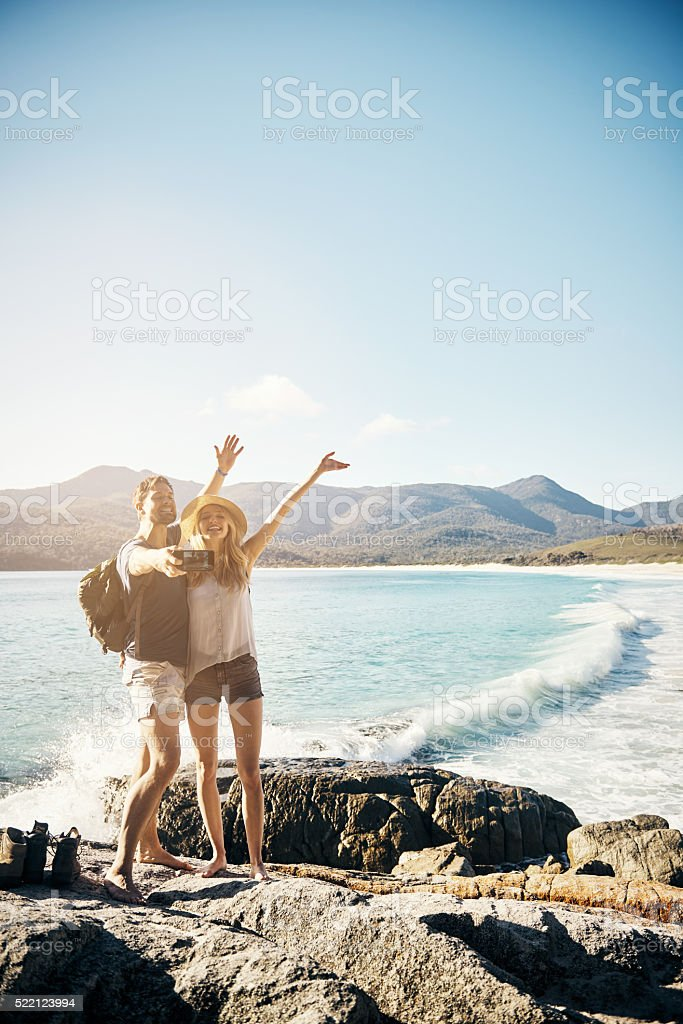 Celebrating our love at the beach stock photo