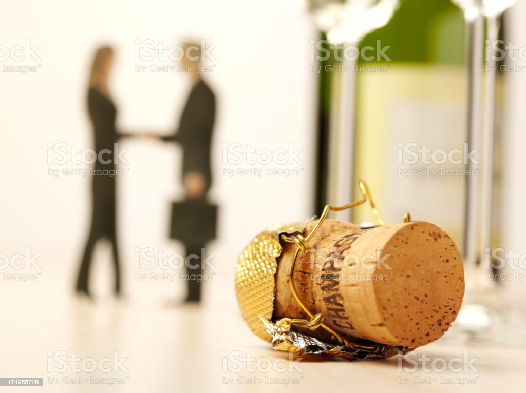 'Celebrating Success with Champagne Glasses, Bottle and Cork' stock photo