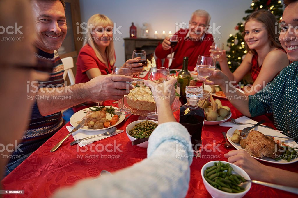 Celebrating the christmas eve with family stock photo