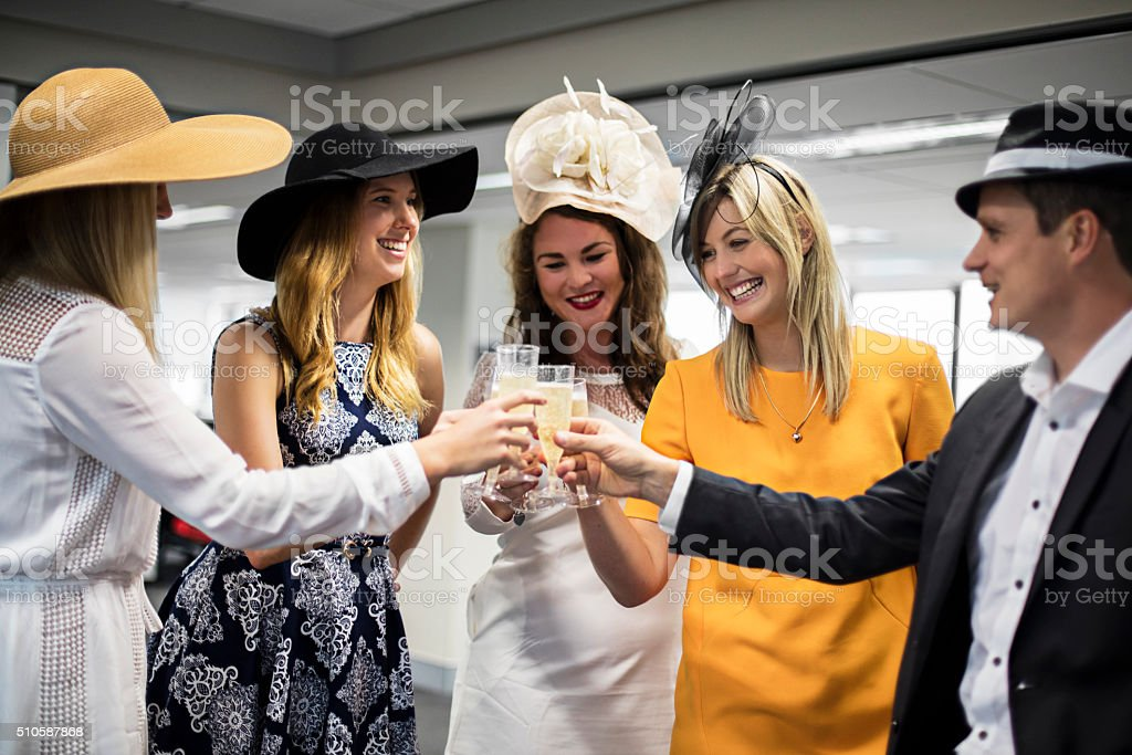 Celebrating the Melbourne Cup in the offfice stock photo