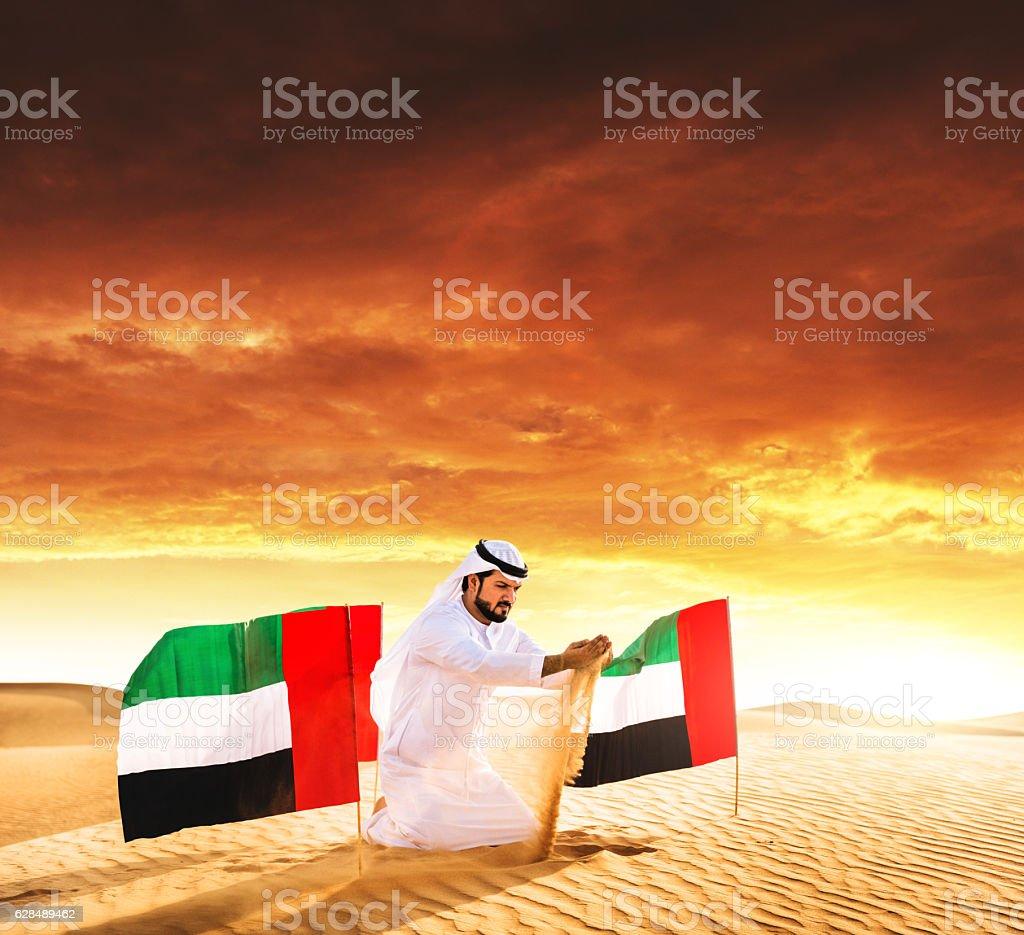 celebrating the uae national day on the desert stock photo