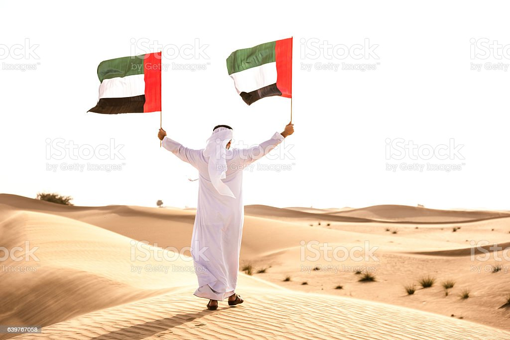 celebrating the uae national day on the desert stock photo
