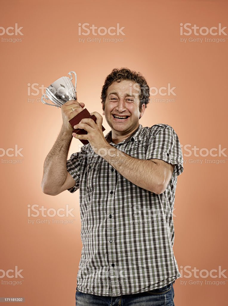 celebrating with trophy royalty-free stock photo