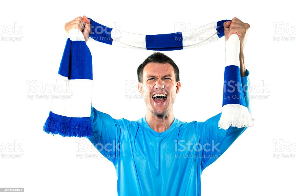 Celebrating young soccer supporter with team scarf stock photo