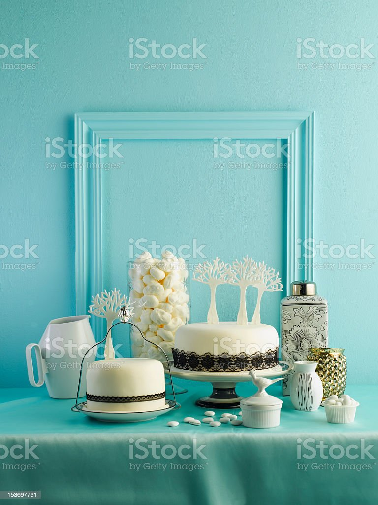 Celebration cake contrasted against a blue wall stock photo