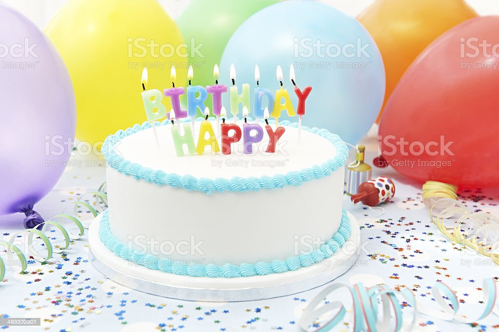 Celebration Cake With Candles Spelling Happy Birthday royalty-free stock photo