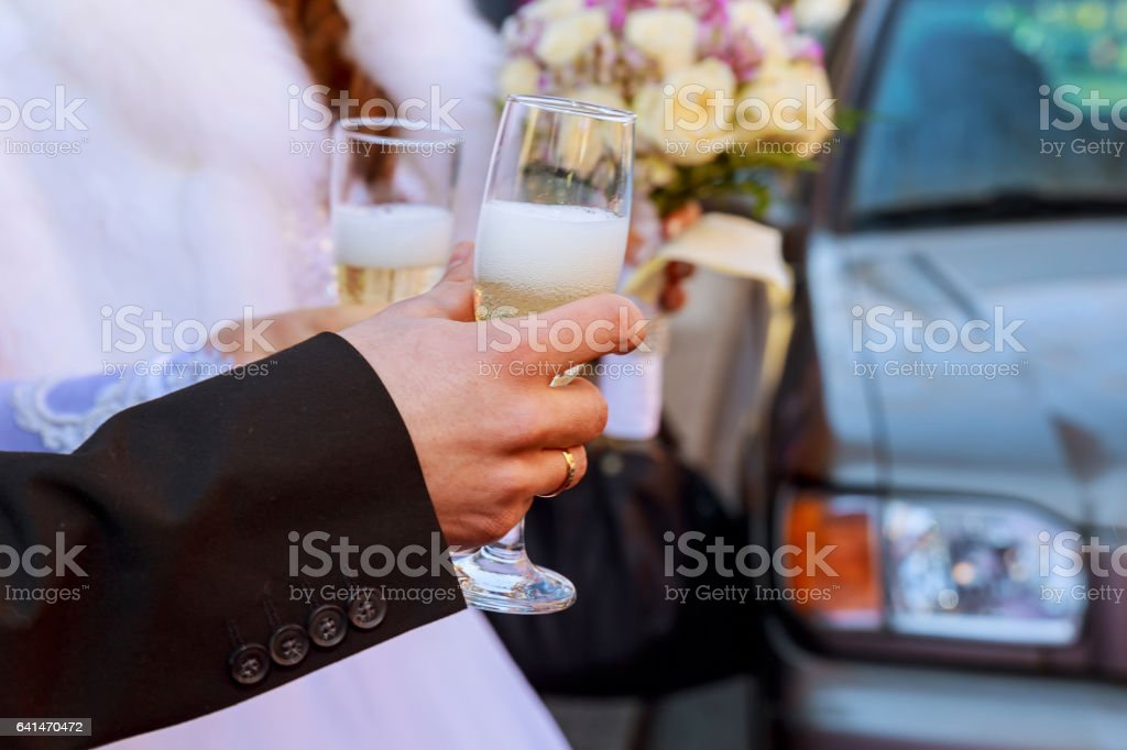 Celebration. Couple holding glasses of champagne making a toast. stock photo