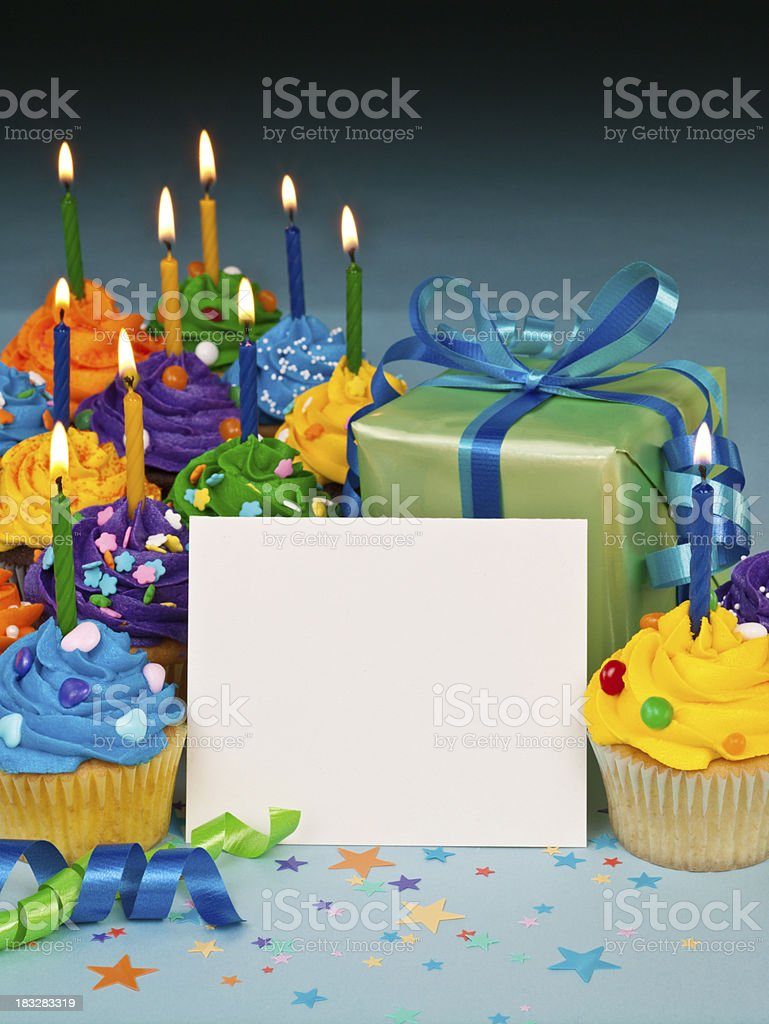 Celebration cupcakes with blank card royalty-free stock photo